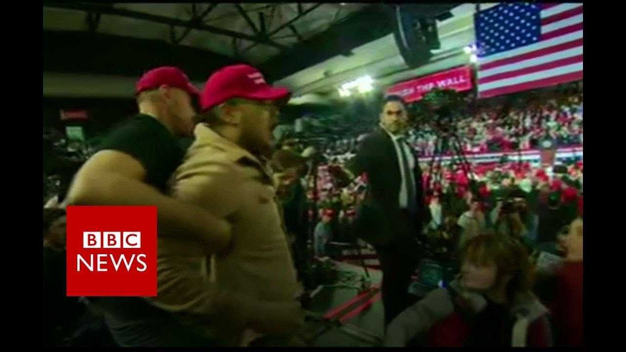 Trump supporter shoves BBC cameraman - BBC News