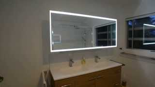 Bathroom mirror and cabinet, powered by Blum