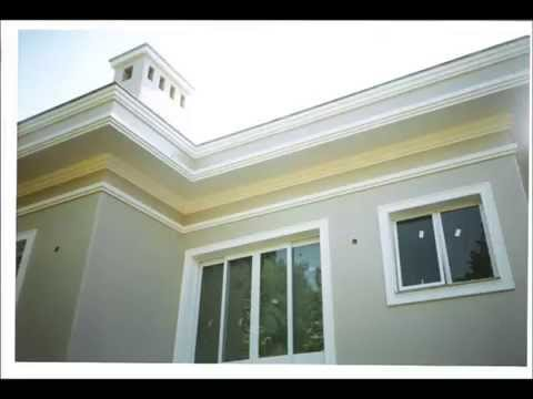 Elaborando una moldura de cemento en una fachada doovi - Molduras para exteriores ...