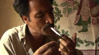Drop in Afghan opium crop, but poor still at risk