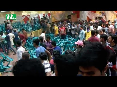 Two rival groups of Chittagong North Chhatra League throw chairs to each others during council