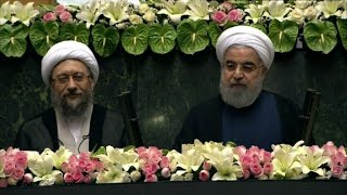 Iran's Rouhani starts new term facing reform criticism