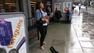 Busking girl in Aberdeen, Scotland
