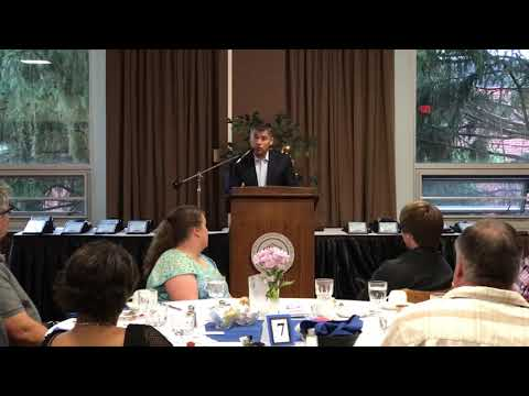 SLU women's hockey coach Chris Wells speaks at Times All-North Section 10 banquet