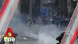 Battlegrounds across Hong Kong as protesters face off with police