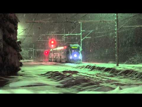 Trains in the evening snow (Croatia)  (4K)