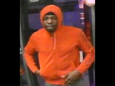 A store surveillance video clearly shows the face of the armed robber.