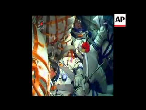 Russian Soyuz spacecraft heading to International Space Station. Two Russians, one American on board