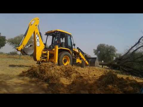 jcb  removed huge tree from gound . most powerful machine