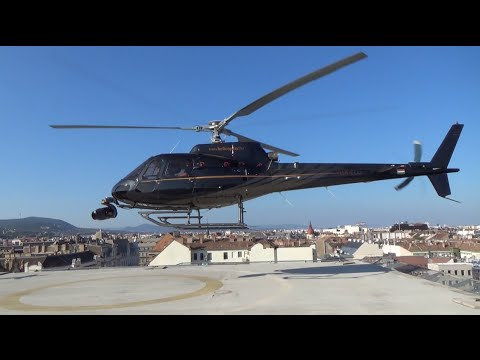AS350 arriving to Hotel President's heliport - HD
