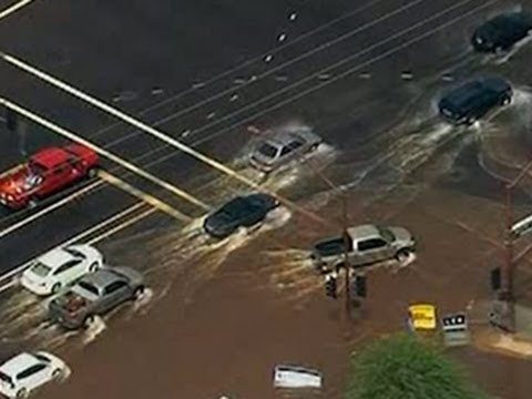 Rain Sets Record for Phoenix, Floods I-10