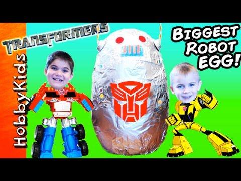 World's BIGGEST ROBOT Surprise Egg! Fighting Transformers + BEST Toys HobbyKidsTV