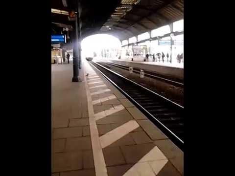 Train heading through Bonn Central Station.