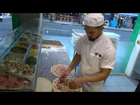 Buying A Freshly Made Hand Stretched Pizza Made By A Master Pizza Maker (Pizzaiolo) At ICCO Pizzeria