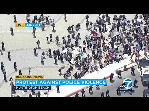 Huntington Beach Protest Declared An Unlawful Assembly, Authorities Say