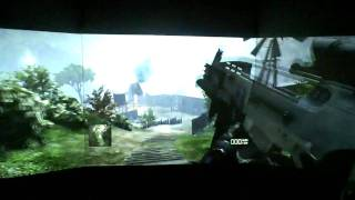 3-screen and 3- projector surround gaming with 1st person shooter game.