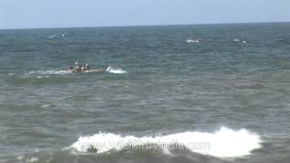 Boat riding the waves - Kanyakumari