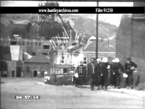 Yorkshire mining village.  Coal Miners leave pit.  Archive Film 91250