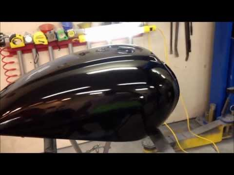 Finishing a paint job on motorcycle a gas tank at the UGG, sanding and detail work