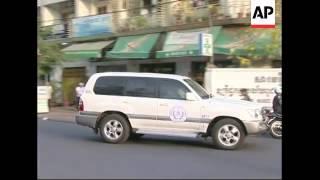 WRAP Fmr head of KR torture centre taken back to Tuol Sleng ADDS departure, s'bite
