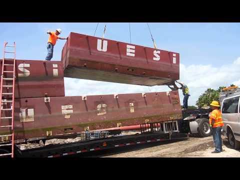 Seawall construction site barge demobilization with crane. V3