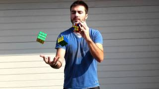 David Calvo juggles and solves Rubik's Cubes
