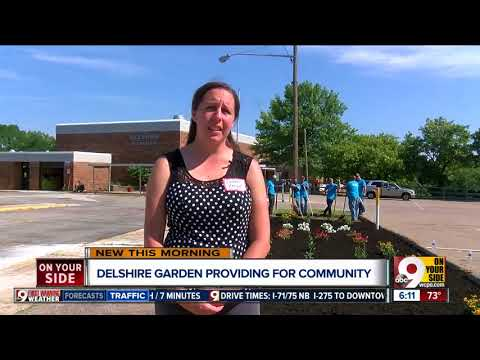 Police, teachers and students help build community garden for Delshire Elementary School