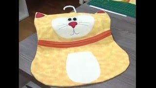 Gato para à lavanderia
