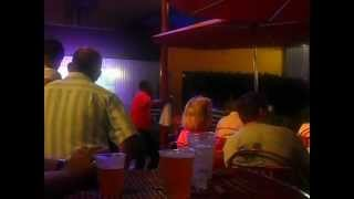 Guy dancing off beat in Paradise Island.
