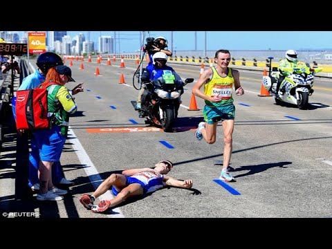 Callum Hawkins collapses from exhaustion during marathon and is left without medical attention