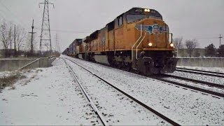 UP 4930 & 7865 lead an EB Pacer Stack Train on a cold snowy morning