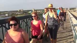 Mindful bridge walk and beach yoga experience