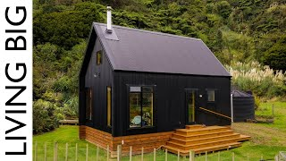 Stunning Black Off-Grid Cabin By The River
