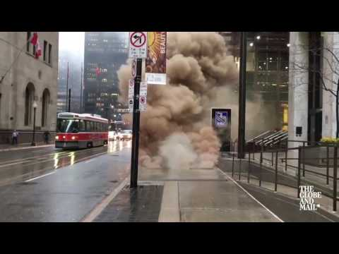 Underground explosions and billowing smoke from hydro vault in downtown Toronto