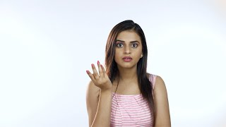 Confused beautiful Indian female with long hair standing and feeling astonished - White background