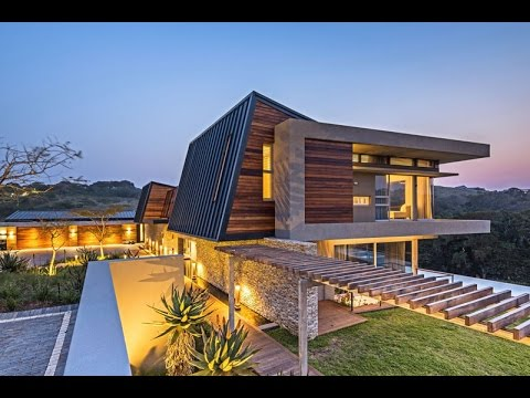 Futuristic Contemporary House Design With Curvaceous Geometric Shapes Known  As Albizia House