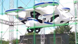 「空飛ぶクルマ」NECが試作機公開