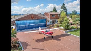 Unique Opportunity for Beautiful Home with Private Airstrip Hangar ~ Video of