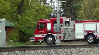 Fire Truck Waits For Train at Crossing Gate