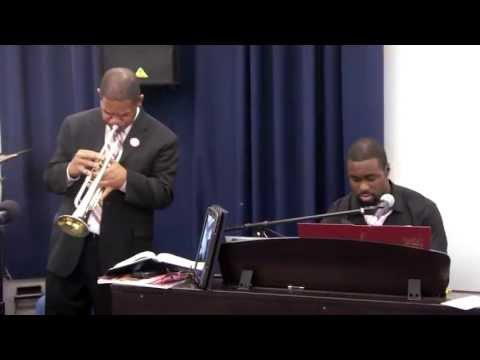 Pastor Ken Stagg with his trumpet Trust and Obey