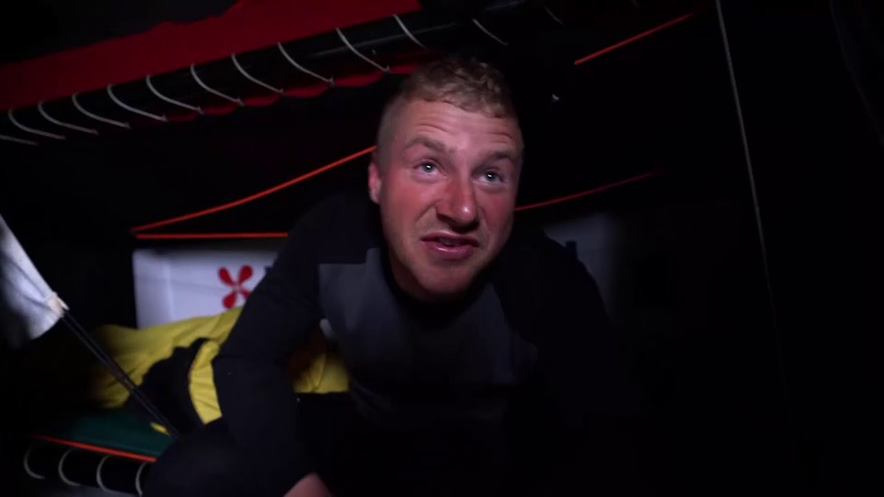 """Brad, at the nav station, grins and gives a thumbs up. """"Beauty! Just got the 24 hour record Just got the confirmation from the boss."""" Simeon, in his bunk: Let's see if we can get over the 600. Brad talks to Nicho in the cockpit about beating Ericcson's record. """"You gotta give me a fist for that."""" He holds out his fist. Nicho pulls his fist away and they laugh. Nicolai in his bunk: This is what it's about. It's hard and exhausting, and you're tired but it's why you want to do the race. Go as fast as you can for days and days, there's no limits... She's a fast boat, this purple bus. She's got some pace to her. I like it. She's a good boat. It's pretty cool; I didn't know that. It's good news to wake up to. Our main focus is still the leg. Gotta keep ourselves in line for the podium. Helmsperson raises his fist, make a peace sign, then a thumbs up. Martine laughs on the pedestal."""