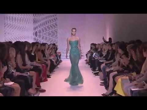 Model Pauline Hoarau trips during Zuhair Murad Haute Couture Fall/Winter 2014-2015