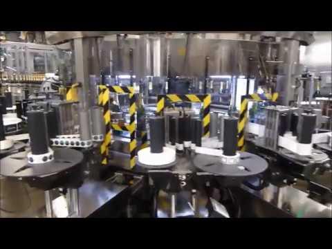 Makro Labeller applying Self Adhesive Labels to Lanson Champagne Bottles
