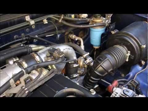 Фото к видео: How to change Fuel Filter on Nissan Navara d22, ZD30 Turbo Diesel Motor