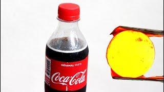 Cocacola com bola de ferro 1000 graus - reação incrível