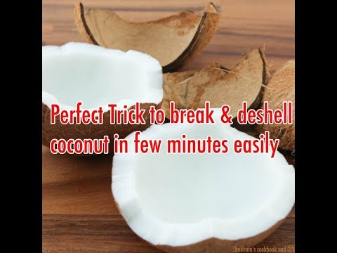 How to break coconut and deshell the flesh easily | thai trick of breaking a coconut