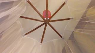 CD-R-King brand portable lithium battery fan in a mosquito net!