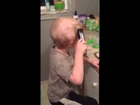 4-year-old-emmett-perrin-combing-his-hair