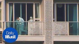 Crime scene investigators seen inside Rurik Jutting's home in 2014 - Daily Mail