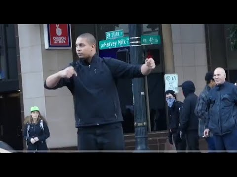 Antifa directing traffic in Portland while police watch